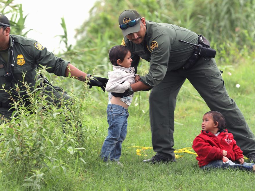 Border Patrol Agents rescue two children near Eagle Pass, Texas. A Texas Republican says stories about abuse at the border aren't true. (Associated Press)