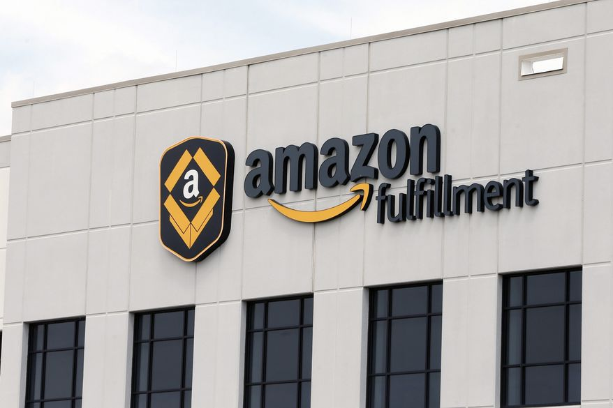 An Amazon warehouse in Minnesota is shown in this July 8, 2019 photo. (AP Photo/Jim Mone) **FILE**