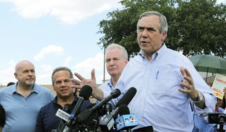 In this June 17, 2018, file photo, U.S. Sen. Jeff Merkley, from right, from Oregon, speaks to the media along with U.S. Sen. Chris Van Hollen, center, D-Md., U.S. Rep. David Cicilline, D-R.I., and U.S. Rep. Mark Pocan, D-Wis., in front of the U.S. Customs and Border Protection's Rio Grande Valley Sector's Centralized Processing Center in McAllen, Texas. (Joel Martinez/The Monitor via AP, File)
