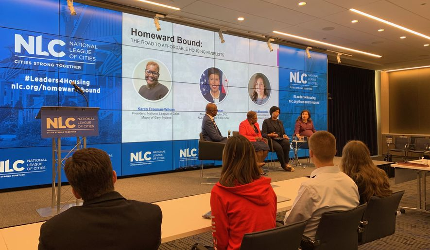 Members of the National League of Cities Housing Task Force present their report highlighting federal and local recommendations to address a shortage of affordable housing on Tuesday, July 9, 2019. (From left: Clarence Anthony, executive director of the National League of Cities; Karen Freeman-Wilson, mayor of Gary, Indiana; D.C. Mayor Muriel Bowser, task force chair; and Teresa Mosqueda, a member of the Seattle City Council.) (Photo by Ximena Bustillo / The Washington Times)