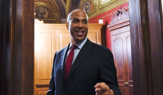 Sen. Cory Booker, D-N.J., goes to a meeting on Capitol Hill in Washington, Tuesday, July 9, 2019. (AP Photo/Susan Walsh) ** FILE **