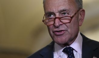Senate Minority Leader Sen. Chuck Schumer of N.Y., center, speaks to reporters following the weekly policy luncheon on Capitol Hill in Washington, Tuesday, July 9, 2019. (AP Photo/Susan Walsh) **FILE**