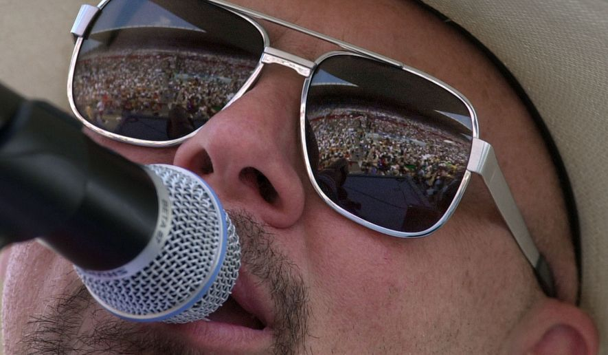 Country music fans are reflected in the glasses of Southern rock group Confederate Railroad lead singer Danny Shirley during a concert in Nashville, Tennessee, June 12, 2000. Confederate Railroad says it has been removed from the DuQuoin State Fair's Grandstand lineup because of its name. Shirley said in a statement, Tuesday, June 9, 2019, that the band is disappointed but thanked fans for their support. The group was scheduled to play Aug. 27, 2019. (AP Photo/Mark Humphrey) ** FILE **