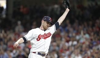 American League pitcher Shane Bieber, of the Cleveland Indians, reacts after striking out National League's Ronald Acuna Jr., of the Atlanta Braves, to end the top of the fifth inning of the MLB baseball All-Star Game, Tuesday, July 9, 2019, in Cleveland. (AP Photo/John Minchillo)