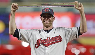 American League pitcher Shane Bieber, of the Cleveland Indians, holds the MVP trophy the MLB baseball All-Star Game, Tuesday, July 9, 2019, in Cleveland. The American League defeated the National League 4-3. (AP Photo/Tony Dejak)