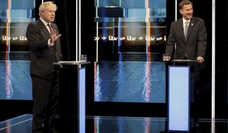 In this photo issued by ITV, showing Britain's Conservative Party leadership candidates Boris Johnson, left, and Jeremy Hunt, during a live head-to-head TV debate hosted by ITV at their studios in Salford, England, Tuesday July 9, 2019. The two contenders, Jeremy Hunt and Boris Johnson are competing for votes from party members, with the winner replacing Prime Minister Theresa May as party leader and Prime Minister of Britain's ruling Conservative Party. (Matt Frost/ITV via AP)