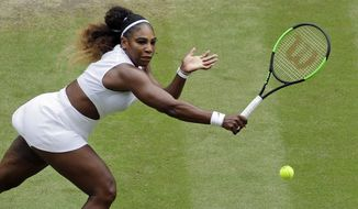 United States' Serena Williams returns to United States' Alison Riske in a Women's quarterfinal singles match on day eight of the Wimbledon Tennis Championships in London, Tuesday, July 9, 2019. (AP Photo/Ben Curtis) ** FILE **