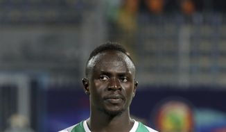 Senegal's Sadio Mane looks out before the African Cup of Nations group D soccer match between Kenya and Senegal in 30 June Stadium in Cairo, Egypt, Monday, July 1, 2019. (AP Photo/Hassan Ammar)