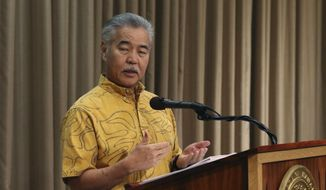 Hawaii Gov. David Ige speaks at a news conference in Honolulu on Tuesday, July 9, 2019 about legislation he will veto. Ige is vetoing a bill that would require websites like Airbnb to collect and pay taxes on behalf of short-term vacation rental hosts. (AP Photo/Audrey McAvoy)