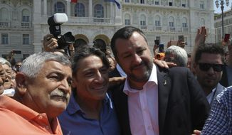 """Italy's deputy prime minister Matteo Salvini, right, is greeted by supporters in Trieste, Italy, Friday, July 5, 2019. Salvini said Friday that Italy is ready to use more resources to """"seal the border with Slovenia and definitively stop the entrance of illegal migrants."""" But he stopped short of mentioning a plan to build an anti-migrant wall along the Slovenian border, previously mentioned by the League's regional governor. (AP Photo)"""