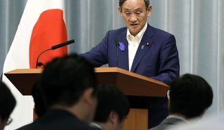 Japan's Chief Cabinet Secretary Yoshihide Suga speaks during a press conference at the prime minister's official residence in Tokyo Tuesday, July 9, 2019. Japan said it has no plans to retract its tightened control on high-tech exports to South Korea, saying it involves Japanese internal policy review. Suga said the review was necessary to appropriately carry out export controls, and that Tokyo does not plan to negotiate its decision with Seoul. (Yohei Kanasashi/Kyodo News via AP)