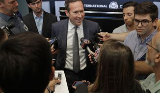 Carolina Panthers president Tom Glick speaks to the media after a news conference in Charlotte, N.C., Tuesday, July 9, 2019. Glick and Carolina Panthers owner David Tepper will travel to New York to meet with Major League Soccer officials in hopes of bringing an expansion team to Charlotte. (AP Photo/Chuck Burton)