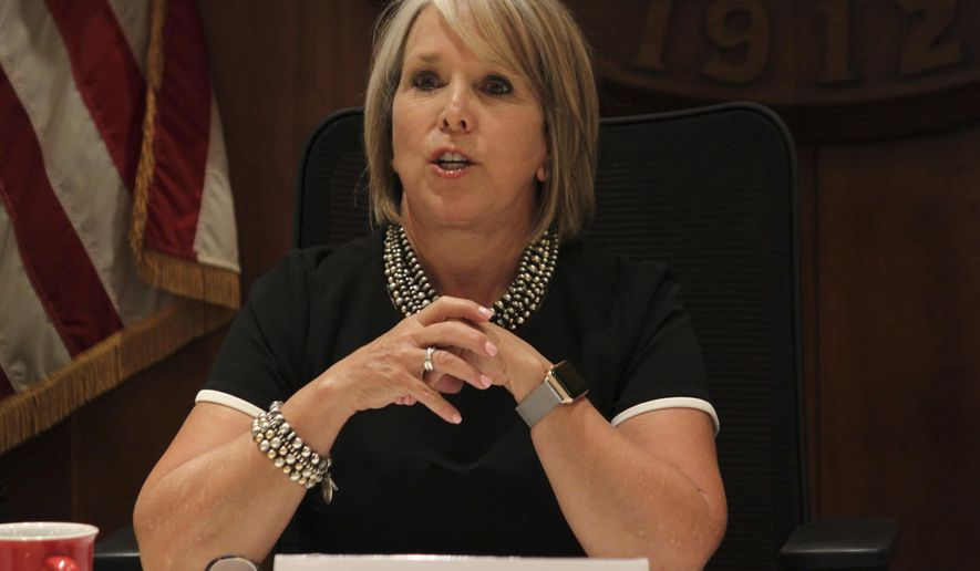 New Mexico Gov. Michelle Lujan Grisham provides a progress report on her first six months in office during a news conference in Santa Fe, New Mexico, on Tuesday, July 9, 2019. (AP Photo/Susan Montoya Bryan)