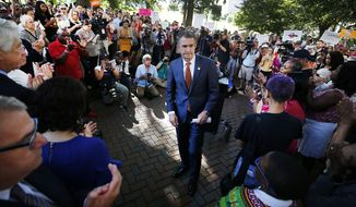 Gov. Ralph Northam walks away from the lectern after speaking at a rally against gun violence held on the Virginia State Capitol grounds, in Richmond, Va., Tuesday, July 9, 2019. (Joe Mahoney/Richmond Times-Dispatch via AP)