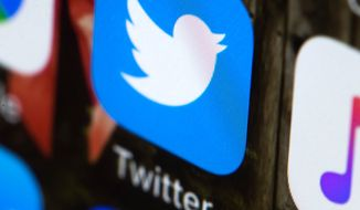FILE - This April 26, 2017, file photo shows the Twitter app on a mobile phone in Philadelphia.  Twitter will now prohibit hate speech that targets religious groups using dehumanizing language. The social network already bans hateful language related to religion when it's aimed at individuals. The change broadens that rule to forbid language that likens members of religious groups to subhumans or vermin. (AP Photo/Matt Rourke, File)