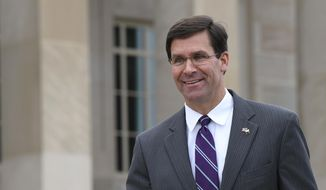 Acting Secretary of Defense Mark Esper waits for the arrival of Qatar's Emir Sheikh Tamim bin Hamad Al Thani to the Pentagon in Washington, Monday, July 8, 2019. (AP Photo/Susan Walsh)