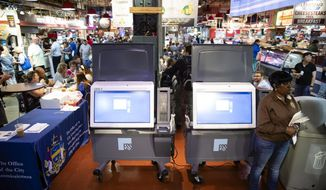 In this Thursday, June 13, 2019 photo, ExpressVote XL voting machines are displayed during a demonstration at the Reading Terminal Market in Philadelphia. (AP Photo/Matt Rourke)