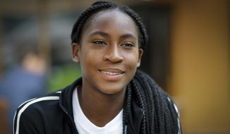 "United States' Cori ""Coco"" Gauff speaks to The Associated Press during the Wimbledon Tennis Championships in London, Tuesday, July 9, 2019. A day after her memorable Wimbledon ended, Coco Gauff already was thinking about coming back. ""Obviously, there's always room for improvement,"" Gauff said in an interview with The Associated Press at the All England Club on Tuesday.(AP Photo/Ben Curtis) ** FILE **"