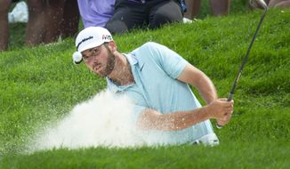 Matthew Wolff hits from a bunker on the 12th hole during the final round of the 3M Open golf tournament Sunday, July 7, 2019, in Blaine, Minn. (AP Photo/Andy Clayton- King)