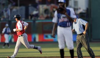 Liberty Division's Mike Ohlman, left, of the Somerset Patriots, runs the bases after hitting a two-run home run off Freedom Division's Daryl Thompson, right, of the Southern Maryland Blue Crabs, during the second inning of the Atlantic League All-Star minor league baseball game, Wednesday, July 10, 2019, in York, Pa. (AP Photo/Julio Cortez)