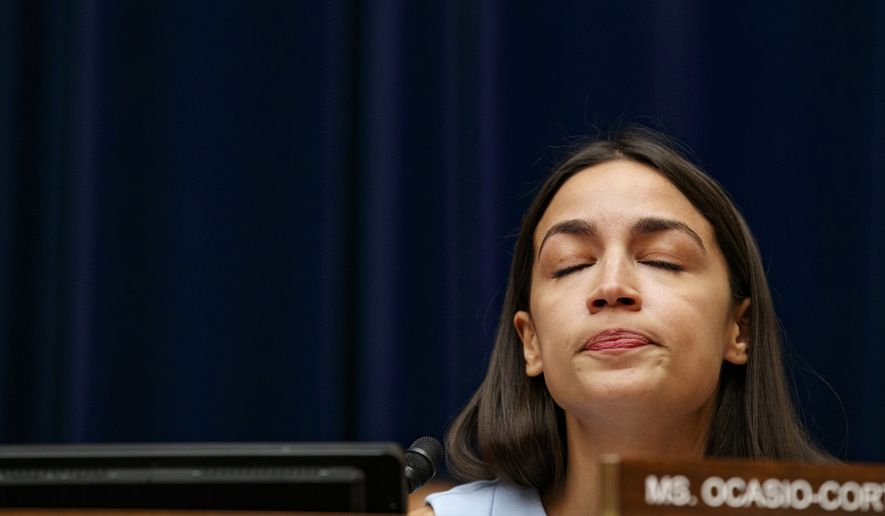 Rep. Alexandria Ocasio-Cortez, D-N.Y., reacts to testimony by Yazmin Juárez, whose daughter Mariee, 1, died after being released from detention by U.S. Immigration and Customs Enforcement (ICE), during a House Oversight on Civil Rights and Civil Liberties subcommittee hearing on treatment of immigrant children at the southern border, Wednesday, July 10, 2019, on Capitol Hill in Washington. (AP Photo/Jacquelyn Martin)