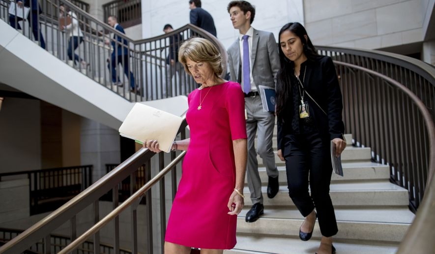 Sen. Lisa Murkowski, R-Alaska, arrives for a closed-door meeting for senators on election security on Capitol Hill in Washington, Wednesday, July 10, 2019. (AP Photo/Andrew Harnik) ** FILE **