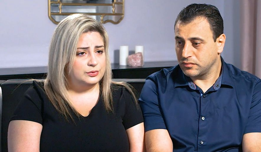 In this Monday, July 8, 2019, photo taken from video provided by Peiffer Wolf Carr & Kane, Anni, left, and Ashot Manukyan describe their lawsuit against a fertility clinic during an interview in Los Angeles. The Southern California couple claim their embryo was mistakenly implanted in a New York woman, who gave birth to their son as well as a second boy belonging to another couple. The lawsuit by the Manukyans describes an alleged in vitro fertilization mix-up by CHA Fertility Center in Los Angeles that involves three separate couples. (Peiffer Wolf Carr & Kane via AP)