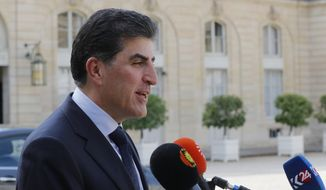 President of the Iraq's self-governing Kurdish region Nechirvan Barzani speaks to the media after a meeting with French President Emmanuel Macron at the Elysee Palace in Paris, France, Wednesday, July 10, 2019. (AP Photo/Michel Euler)