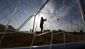 "Immigrants play soccer at the U.S. governments newest holding center for migrant children in Carrizo Springs, Texas. The Department of Health and Human Services, which holds immigrant children unaccompanied by a parent under federal law, says about 225 children are currently held at a former ""man camp"" for oilfield workers. (AP Photo/Eric Gay)"