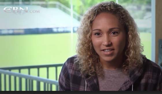 Jaelene Hinkle, a professional women's soccer player shown here in a 2018 CBN interview, famously refused to wear rainbox-colored jerseys in honor of LGBT Pride Month in a 2017 friendly match. Many observers believe Ms. Hinkle's faith-informed decision, considered by detractors to have been homophobic, was a factor in her not making the roster for the 2019 U.S. Women's National Team. (CBN.com screen capture)
