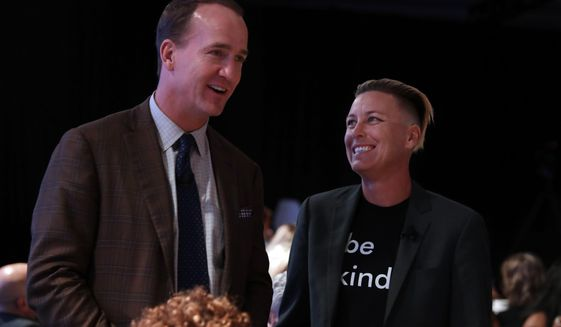 Former U.S. Women's Soccer national team member Abby Wambach and former NFL quaterback Peyton Manning chat during the High School Athlete of the Year Awards Tuesday, July 9, 2019, in Los Angeles. (AP Photo/Marcio Jose Sanchez)