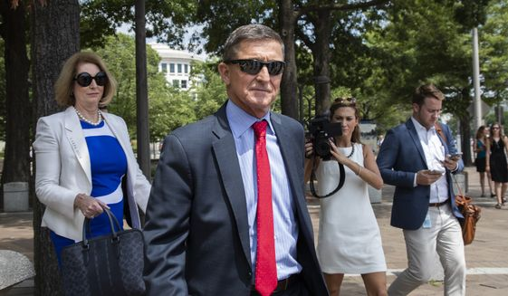 In this June 24, 2019, photo, former National Security Adviser Michael Flynn, leaves the federal courthouse in Washington. with his lawyer Sidney Powell, left. (AP Photo/Manuel Balce Ceneta) ** FILE **