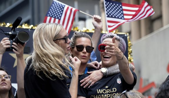 U.S. women's soccer team players Allie Long, left, Ashlyn Harris, center, and Megan Rapinoe celebrates during a ticker tape parade along the Canyon of Heroes, Wednesday, July 10, 2019, in New York. The U.S. national team beat the Netherlands 2-0 to capture a record fourth Women's World Cup title. (AP Photo/Craig Ruttle) **FILE**