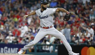National League pitcher Sandy Alcantara, of the Miami Marlins, throws during the eighth inning of the MLB baseball All-Star Game against the American League, Tuesday, July 9, 2019, in Cleveland. (AP Photo/John Minchillo)