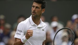 Serbia's Novak Djokovic celebrates winning the second set against Belgium's David Goffin during a men's quarterfinal match on day nine of the Wimbledon Tennis Championships in London, Wednesday, July 10, 2019. (AP Photo/Tim Ireland)