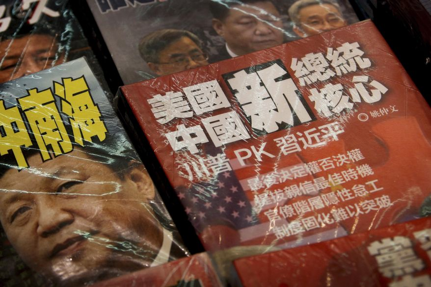 In this Thursday, July 4, 2019, photo, magazines with a front cover featuring Chinese President Xi Jinping against U.S. President Donald Trump, trade war and the South China Sea is placed on sale at a roadside bookstand in Hong Kong. The top U.S. and Chinese trade envoys have talked by phone in their first contact since Presidents Donald Trump and Xi Jinping agreed to resume stalled talks on ending a tariff war. (AP Photo/Andy Wong)