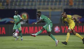 Senegal's Idrissa Gana Gueye scores during the African Cup of Nations quarterfinal soccer match between Senegal and Benin in 30 June stadium in Cairo, Egypt, Wednesday, July 10, 2019. (AP Photo/Hassan Ammar)