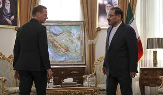 French presidential envoy Emmanuel Bonne, left, is welcomed by Secretary of Iran's Supreme National Security Council Ali Shamkhani for a meeting in Tehran, Iran, Wednesday, July 10, 2019. (AP Photo/Vahid Salemi)