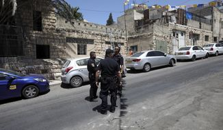 Israeli police stand in front of a house after a Palestinian family was evicted in east Jerusalem's neighborhood of Silwan, Wednesday, July 10, 2019. Officers removed the Siyyam family from the premises on Wednesday after an Israeli court ruled in favor of Elad, an Israeli group working to strengthen Jewish presence in east Jerusalem. (AP Photo/Mahmoud Illean)