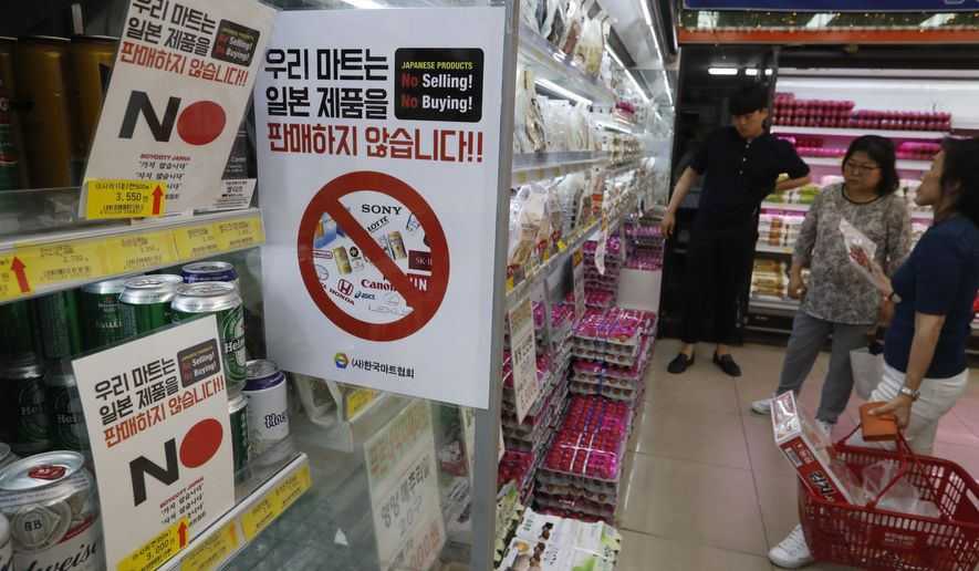 """FILE - In this Tuesday, July 9, 2019, file photo, notices campaigning for a boycott of Japanese-made products are displayed at a store in Seoul, South Korea. South Koreans believe Japan still hasn't fully acknowledged responsibility for atrocities committed during its 1910-45 colonial occupation of Korea. Thousands of South Koreans have signed petitions posted on the presidential office's website that call for boycotting Japanese products and travel to Japan. The signs read: """"We don't sell Japanese products."""" (AP Photo/Ahn Young-joon)"""