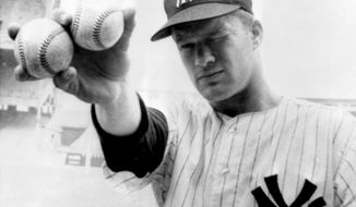 "FILE - In this Oct. 14, 1964 file photo, New York Yankees pitcher Jim Bouton takes aim as he holds two balls in the right hand that his teammates hope will lead them to victory in the sixth World Series game in New York. Jim Bouton, the New York Yankees pitcher who shocked the conservative baseball world with the tell-all book ""Ball Four,"" has died, Wednesday, July 10, 2019. He was 80.(AP Photo/File)"