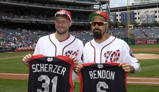 Washington Nationals' Max Scherzer, left, and Anthony Rendon, right, pose with All-Star jerseys before a baseball game against the Kansas City Royals, Sunday, July 7, 2019, in Washington. (AP Photo/Nick Wass) **FILE**