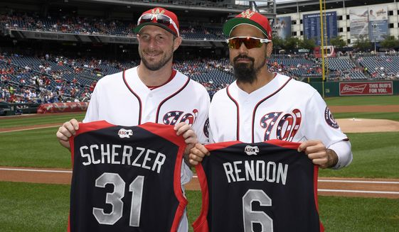 Washington Nationals' Max Scherzer, left, and Anthony Rendon, right, pose with All-Star jerseys before a baseball game against the Kansas City Royals, Sunday, July 7, 2019, in Washington. (AP Photo/Nick Wass)