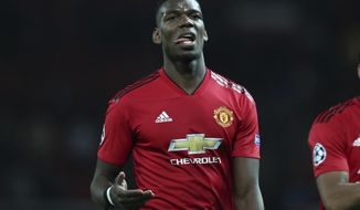 "FILE - In this April 10, 2019, file photo, Manchester United's Paul Pogba reacts after the Champions League quarterfinal, first leg, soccer match between Manchester United and FC Barcelona at Old Trafford stadium in Manchester, England. Manchester United manager Ole Gunnar Solskjaer deflected questions over the future of France midfielder Pogba, saying Wednesday, July 10, 2019 that Pogba has ""never been a concern"" for him and that Manchester United doesn't have to sell any player. (AP Photo/Jon Super, File)"
