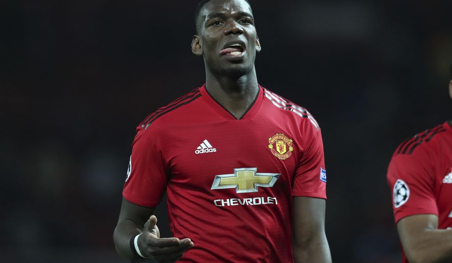 """FILE - In this April 10, 2019, file photo, Manchester United's Paul Pogba reacts after the Champions League quarterfinal, first leg, soccer match between Manchester United and FC Barcelona at Old Trafford stadium in Manchester, England. Manchester United manager Ole Gunnar Solskjaer deflected questions over the future of France midfielder Pogba, saying Wednesday, July 10, 2019 that Pogba has """"never been a concern"""" for him and that Manchester United doesn't have to sell any player. (AP Photo/Jon Super, File)"""