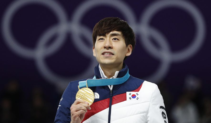 FILE - In this Feb. 24, 2018, file photo, Gold medalist Lee Seung-hoon of South Korea celebrates on the podium of the men's mass start speedskating race at the Gangneung Oval at the 2018 Winter Olympics in Gangneung, South Korea. South Korea's skating body on Wednesday, July 10, 2019, has decided to ban two-time Olympic speed skating champion Lee for a year over allegations that he assaulted two teammates during several international competitions. (AP Photo/John Locher, File)