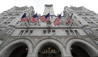 This Dec. 21, 2016, file photo, shows the arched facade of The Trump International Hotel at 1100 Pennsylvania Avenue NW, in Washington. (AP Photo/Alex Brandon, File)