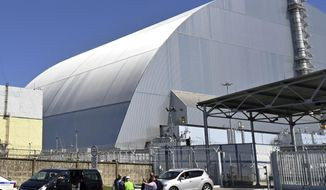 FILE - This June 1, 2019, file photo shows a view of the New Safe Confinement (NSC) movable enclosure at the nuclear power plant in Chernobyl, Ukraine. A new structure built to confine the Chernobyl nuclear reactor at the center of the world's worst nuclear disaster has been previewed for the media. (Sergei Supinsky/Pool Photo via AP, File)