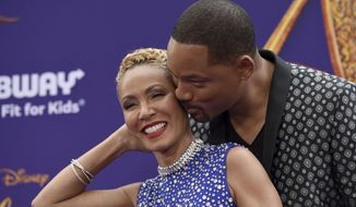 """FILE - In this May 21, 2019 file photo, Will Smith, right, kisses Jada Pinkett Smith as they arrive at the premiere of """"Aladdin"""" at the El Capitan Theatre in Los Angeles. The Hollywood power couple on Wednesday announced the launch of a new media venture. According to a statement, Westbrook Inc. will be a cross-platform holding company """"formed to execute the Smith family's global content and commerce business strategy."""" (Photo by Chris Pizzello/Invision/AP, File)"""
