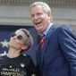 Women's soccer star Megan Rapinoe strikes a pose with New York City Mayor Bill de Blasio, one of 24 Democratic presidential hopefuls. (Associated Press)